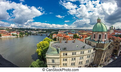 view of the manes bridge with a building of the czech parliament behind it timelapse from Old Town Bridge Tower.