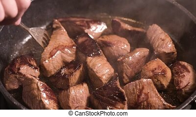 Frying meat on hot pan - Frying beef sirloin in a hot pan....