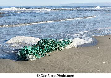 Green fishing net on the beach