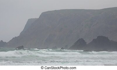 Coastal Cliffs And Ocean Waves Duriing Fog