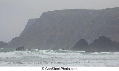 Coastal Cliffs And Ocean Waves Duriing Fog
