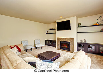 Living room in beige tones with carpet floor and fireplace.