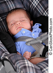 Car Seat Sleep - A newborn sleeping peacefully in his car...