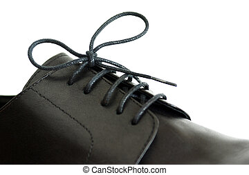 Shoe lace - Close-up on a shoe-lace of a males black shoe