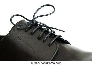 Shoe lace - Close-up on a shoe-lace of a male\'s black shoe