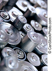 stack of batteries - macro background of many batteries of...