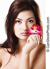 Young beautiful asian model with purple orchid