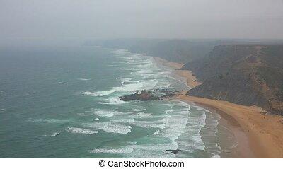 Beaches Clifs And Fog Along Ocean Coast