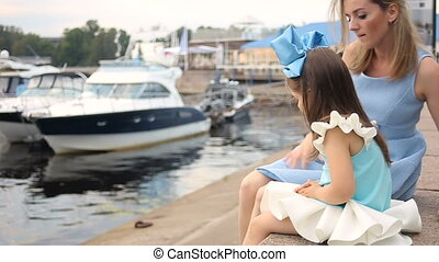 mother and daughter three years in a blue dress and blue big bow