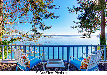 Walkout deck  with chairs and amazing water view