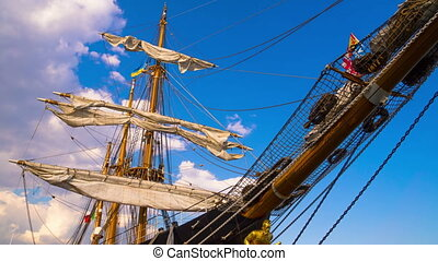 The Masts of Sailing Ship. - Clouds over the Masts of...
