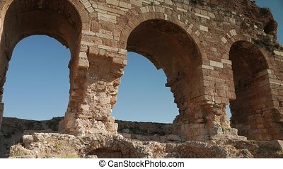 Zooming of medieval greek archs in ruined city of Tralleis,...