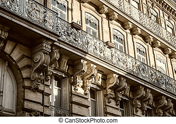 Toulouse facade - Ornate facade of a building with wrought...