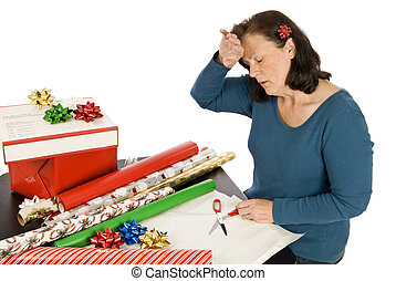 Holiday Stress - A middle aged woman puts her hand to her...