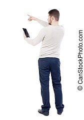 Back view of pointing young men talking on cell phone. -...