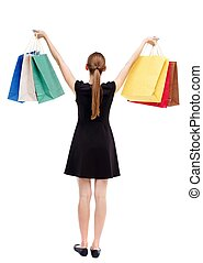back view of woman with shopping bags Isolated over white...