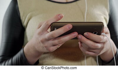 Closeup of teenage girl hands with smart phone indoors -...