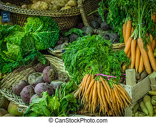 Fresh vegetables in boxes on sale