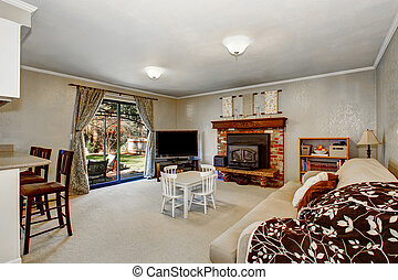 Open floor plan living room with fireplace, carpet floor....