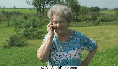Old woman 80s telling on the smartphone outdoors - Old woman...