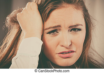 Stressed young woman pulling hair - Emotions,stressful...