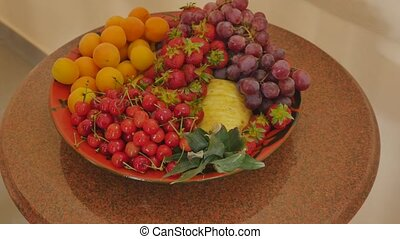 Assortment of juicy fruits on wooden table.