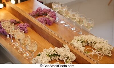 Elegant Glasses with Champagne Standing in a Row.