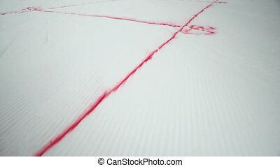 Red spray marks on snowboarding trail. Snowy mountain. Cameraman. Ski resort. Challenge. Competition