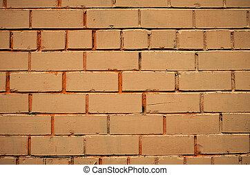 Background of yellow brick wall. Grunge style.