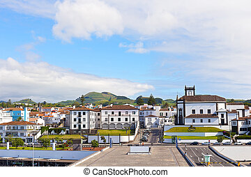 View on Ponta Delgada, Azores. - White houses with colorful...
