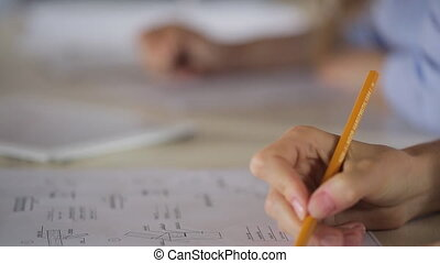Close-up view of woman filling form Sitting at desk young...