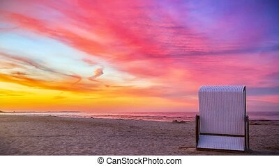 Holiday - Beach Chair - Sunset - Video of a single beach...