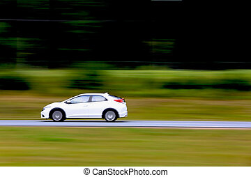Fast White Car on Freeway - Small white car in high speed on...