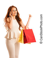 Woman with shopping bags talking on smart phone after a...