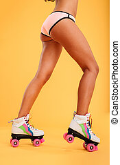 Cropped image of a women in bikini and legs wearing rollers...
