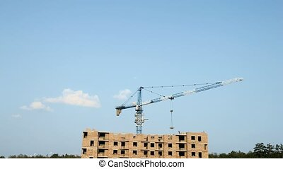 Crane at building site - Time lapse. Crane working at...