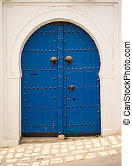 Blue door in Andalusian style from Sidi Bou Said in Tunisia