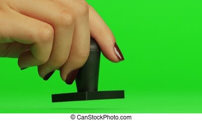 Stamp. Close up. Green screen - Stamp, put a stamp on the...