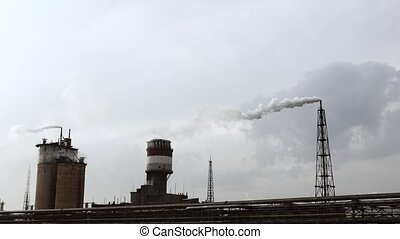 Power station smoking on cloudy sky