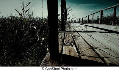 Old wooden bridge in mountains horizontal dolly shot. Close...