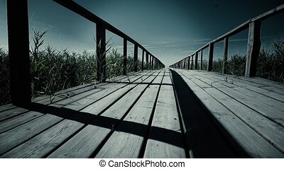 Epic wooden bridge in mountains horizontal dolly shot. Close...