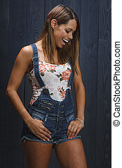 Laughing girl - Sexy girl in short demin overalls laughing