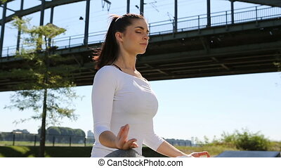 young woman making yoga. urban lifestyle concept
