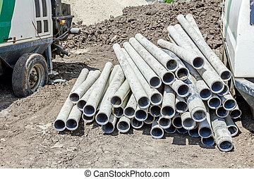 Drill pipe that is used to drill a well - Pile of used pipes...