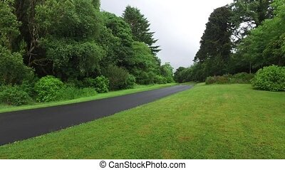 asphalt road at connemara in ireland 12 - travel and...