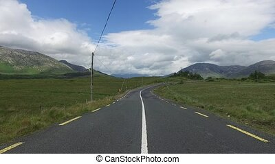 asphalt road at connemara in ireland 28 - travel and...