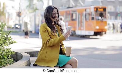 happy young woman with smartphone and headphones -...