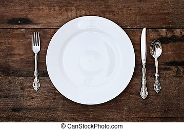 Place setting of a dining set over rustic background - Place...