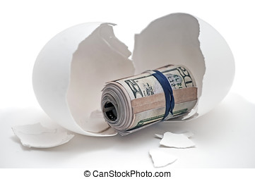 Broken Nestegg - Fake money representing home savings or...