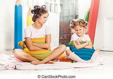 Little girl sitting with her mother